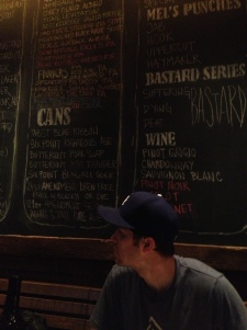 My hubby (<3) checking out the numerous beer options at Mel's Burgers....